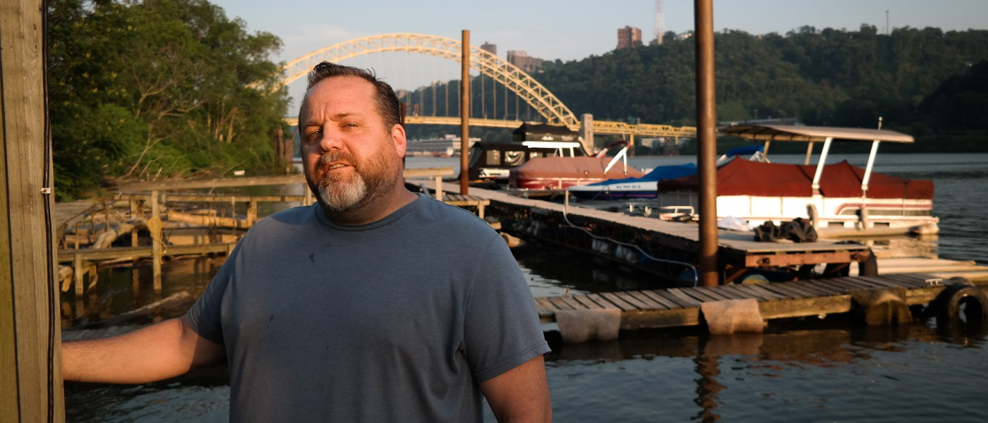Jason Fleming has found his oasis: Living in a trailer on the Ohio River, care-taking a mom-and-pop marina. Photo: Lou Blouin