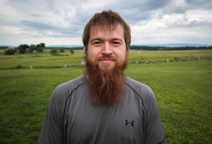 """Kyle Beger, 28, of St. Joseph, Missouri, visits """"The Angle"""" at the Gettysburg battlefield, June 17, 2015. The site marks the place where Confederate soldiers briefly broke the Union line during Pickett's Charge on the third day of the battle. Photo: Lou Blouin"""