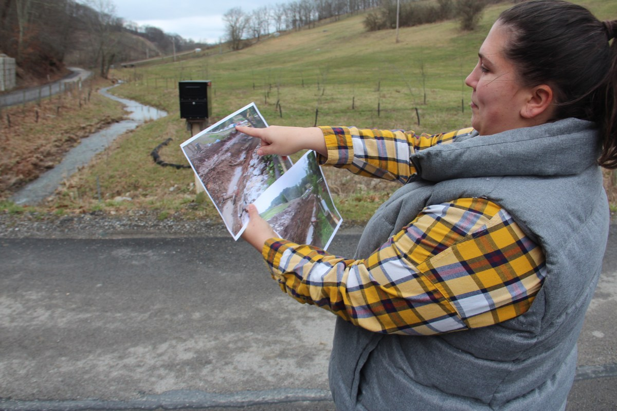 Veronica Coptis shows pictures of reconstruction for Polen Run, a Greene County stream undermined by Consol Energy. Photo: Reid Frazier