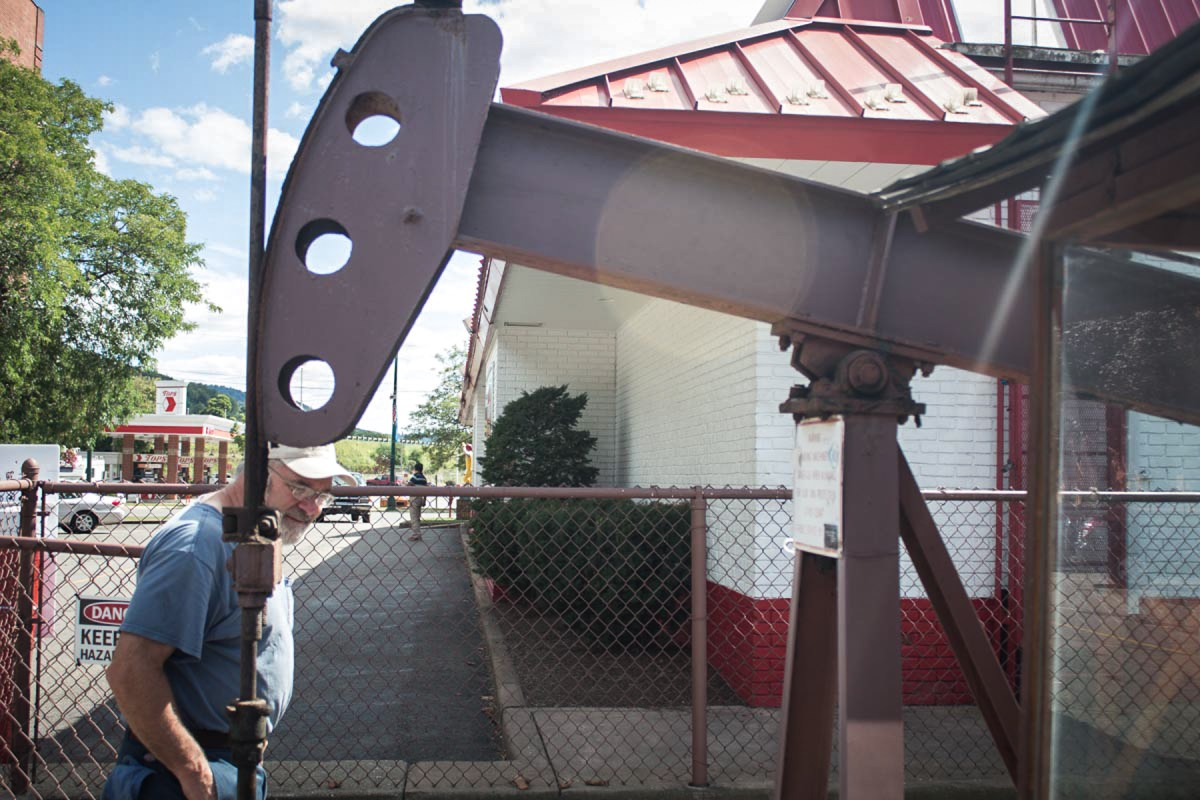 Independent oil producer Tom Miller checks out one of the more unusual relics of Pennsylvania's oil industry: A independently owned oil well that sits behind a McDonald's restaurant in Bradford, Pennsylvania. The 140-year-old oil well, which is still active, has survived despite McDonald's requests to the owner to have it removed from the middle of its drive-thru. Photo: Kevin Brown