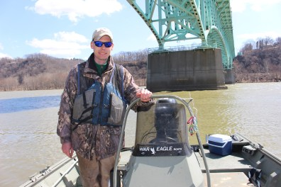 Ryan Miller along the Allegheny River. They checked 100 traps for mudpuppies. Photo: Julie Grant