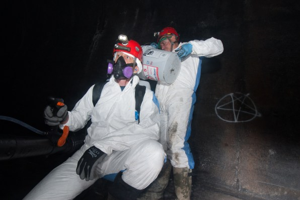 Greg Turner, left and Barrie Overton prepare to spray polyethylene glycol in the tunnel to control the Pd fungus in the summer of 2018. Photo: Pete Pattavina/US Fish and Wildlife