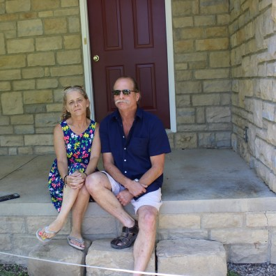 Kerri and Jeff Bond in front of their house. The auction brought in more than $1 million. Photo: Brian Peshek