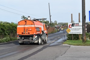 A vehicle cleans the road leading into Erie Coke. Photo: Ed Mahon/PA Post