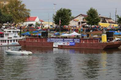 People line the banks of the Ohio River, waiting for the official announcements from the Sternwheel Festival barge. (Photo by Julie Grant/The Allegheny Front)