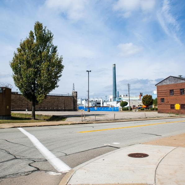 Beaver Avenue in the Woods Run area of Pittsburgh, located in Allegheny County District 13. The State Correctional Institution–Pittsburgh (pictured left) was closed in 2017, but it operated in this location as the Western Penitentiary from 1882-2005. The Allegheny County Sanitary Authority (ALCOSAN) complex (pictured center) was opened adjacent to the prison in 1959, as the largest water sewage treatment center in the United States to that date. The aging city infrastructure contributes to ongoing water quality issues. Photo: Njaimeh Njie