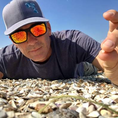 Jace Tunnell, of the University of Texas at Austin, didn't know what nurdles were before last year when he saw thousands of plastic pellets along the beach at Corpus Christi, Texas. (Photo courtesy of Jace Tunnell)