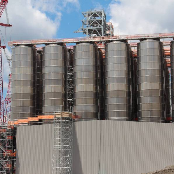 These tanks, shown here in June 2019, will hold the plastic pellets produced by Shell's ethane cracker. According to Shell, 1.6 million metric tons of plastic will be produced there annually. (Photo by Reid Frazier/The Allegheny Front)