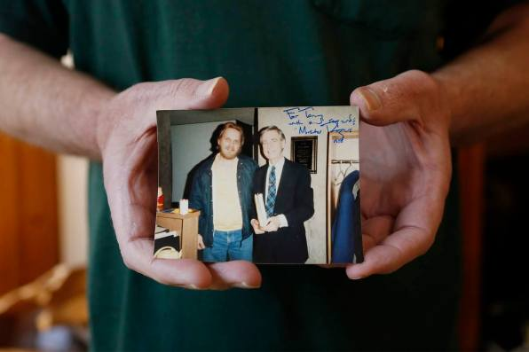 Saw Mill Run resident Anthony Wolkiewicz holds a photo that was taken of him with Fred Rogers of Mister Rogers' Neighborhood while working at WQED in 1977. (Photo by Ryan Loew/PublicSource)