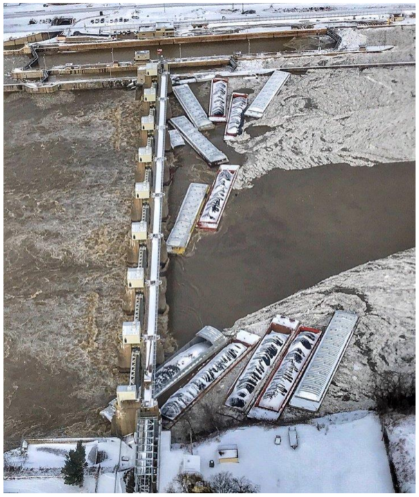 Aerial photo of barges against the Emsworth Locks and Dam after the breakaway on Jan. 13, 2018. (Photo by U.S. Coast Guard)