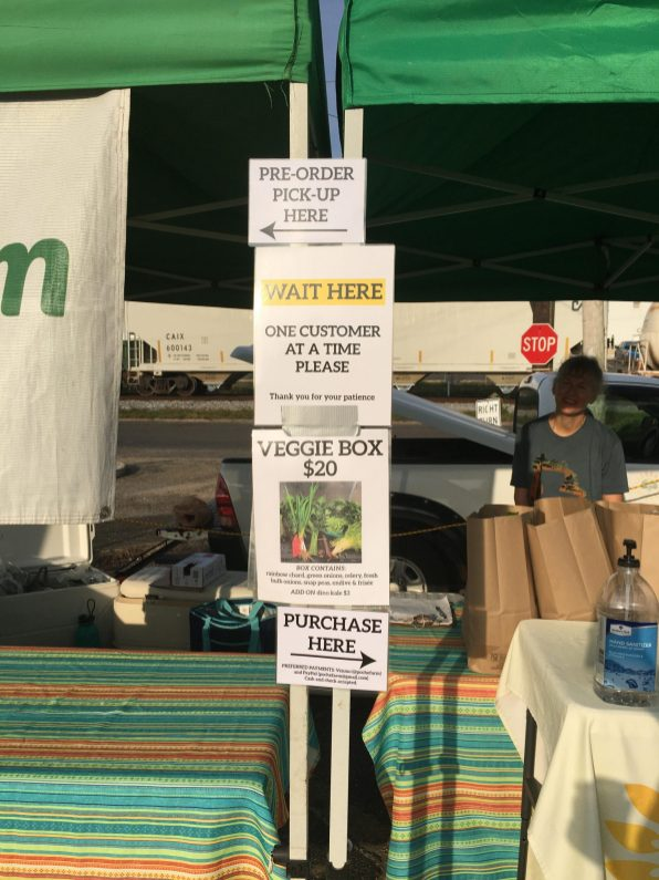 The Poche Family Farm in New Orleans has put up new signage, and new ways to exchange payment at its table. It's one example of new safety practices at farmers markets because of covid-19. Courtesy Farmers Market Coalition.