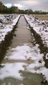 Flooded trench with snow