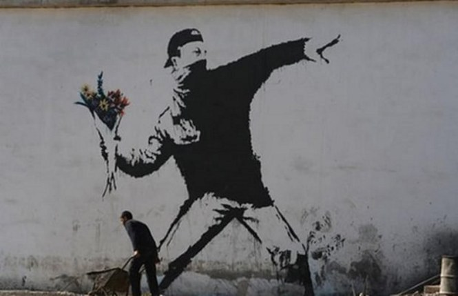Flower Thrower - TOP 10 GRAFFITI ARTWORKS BY BANKSY