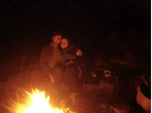 Couple enjoying cooking over fire