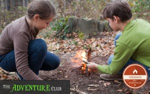 Boy and girl make campfire