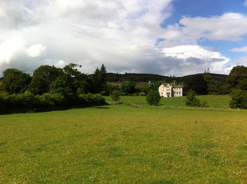 Bamff house surrounded by hills and trees
