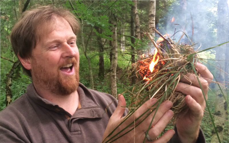 Malcolm firemaking in woods