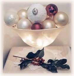 illuminated bowl of Christmas ornaments