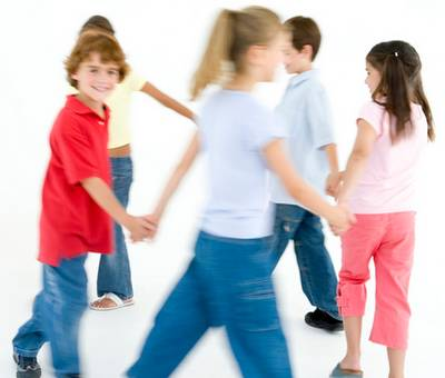 young children playing The More We Get Together in a circle