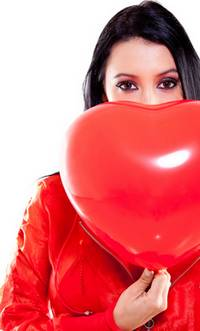 woman with heart shaped valentine balloon