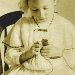 girl spool knitting in early 1900s