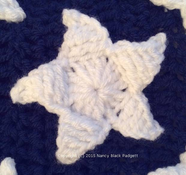 close-up of crocheted star on American flag afghan