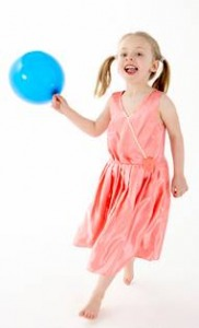 girl catching a balloon