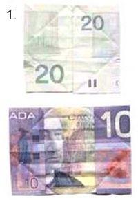 folding paper money to make a butterfly