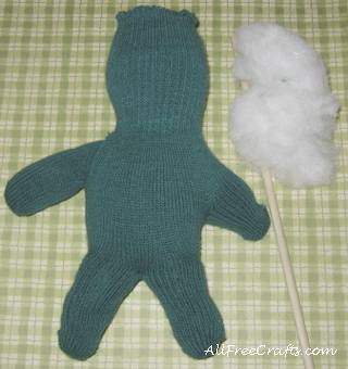 stuffing the glove doll