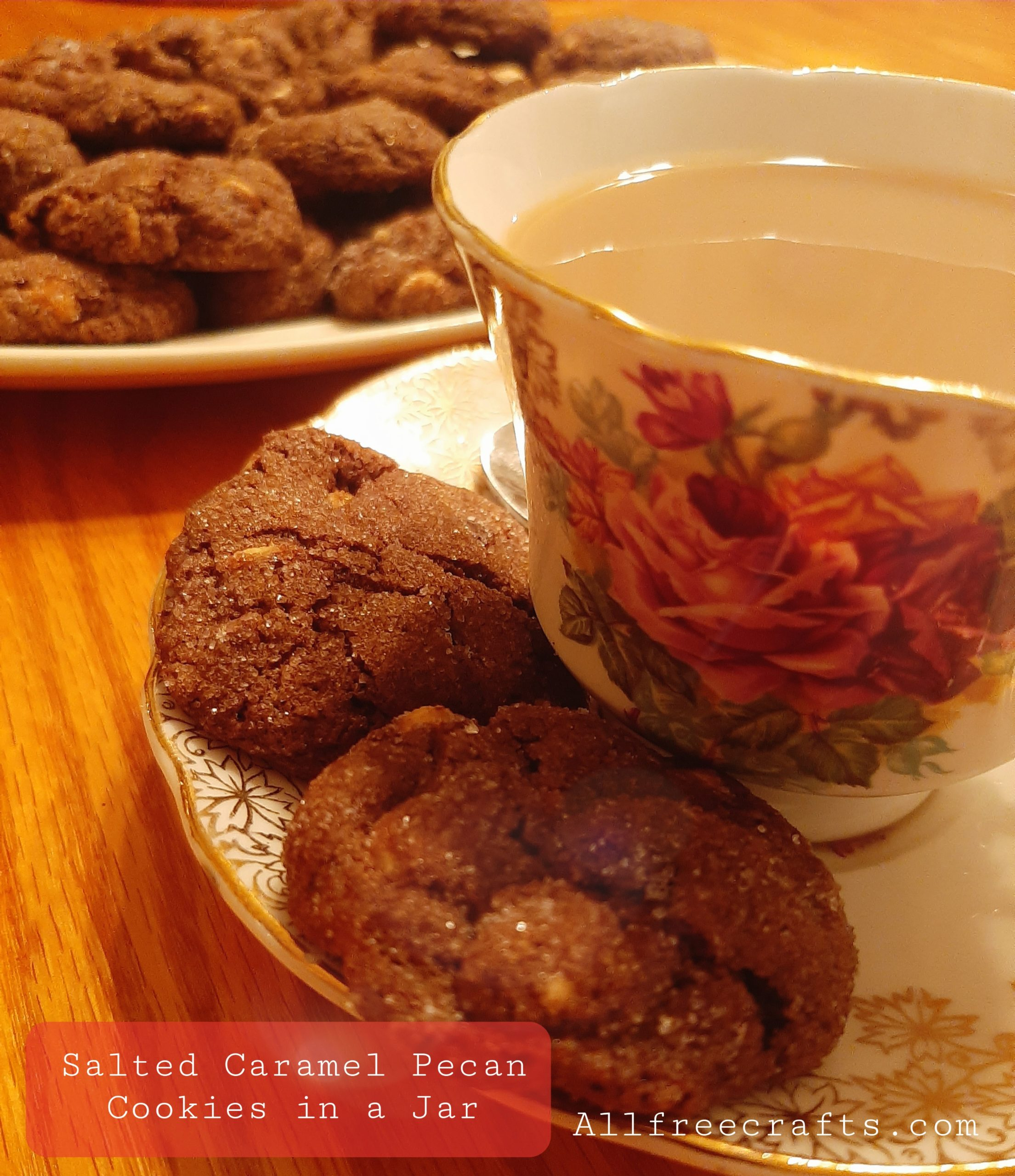 salted caramel pecan cookies with a cup of tea