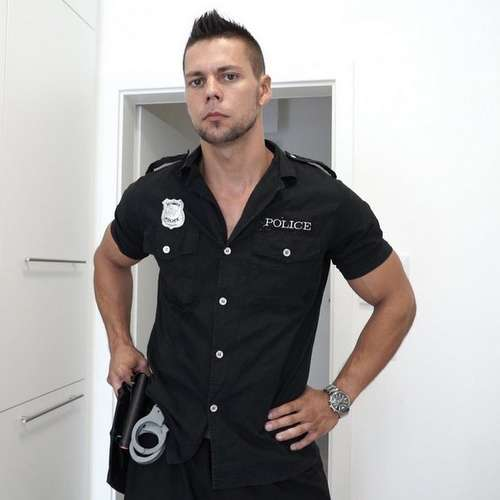 sexy officer takes off his uniform
