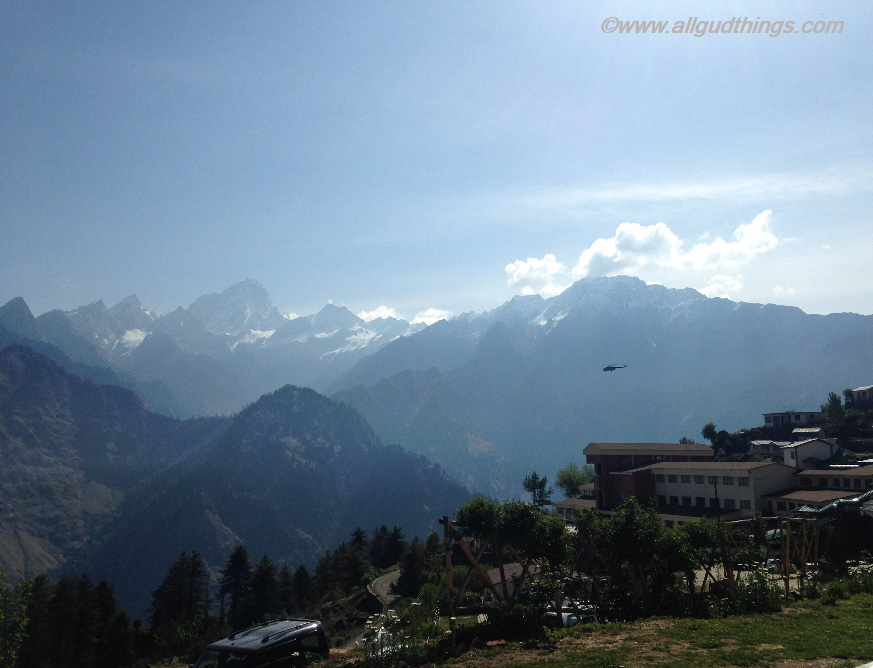 Helicopter flying in between the Himalayan ranges at auli in uttarakhand- Auli in Summers
