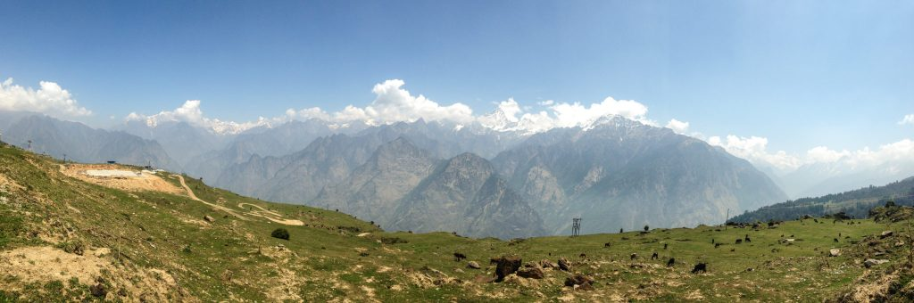 Himalayan ranges and green meadows at Auli in summer, uttarakhand