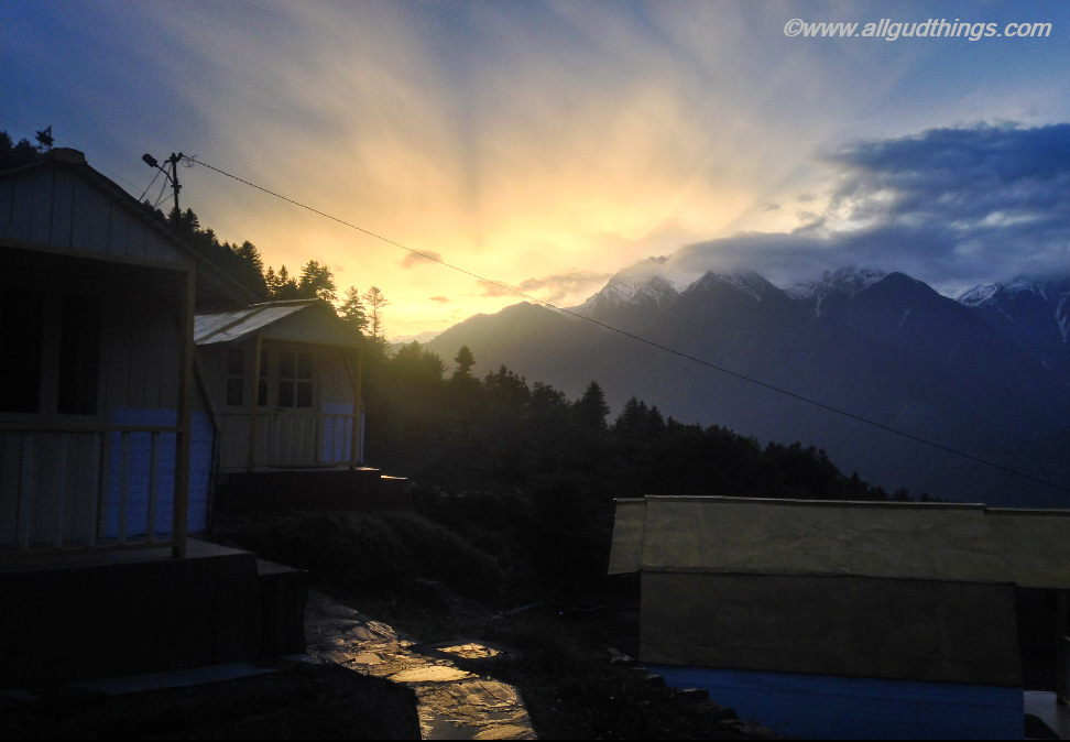 Sunset at Auli in summers along with rain