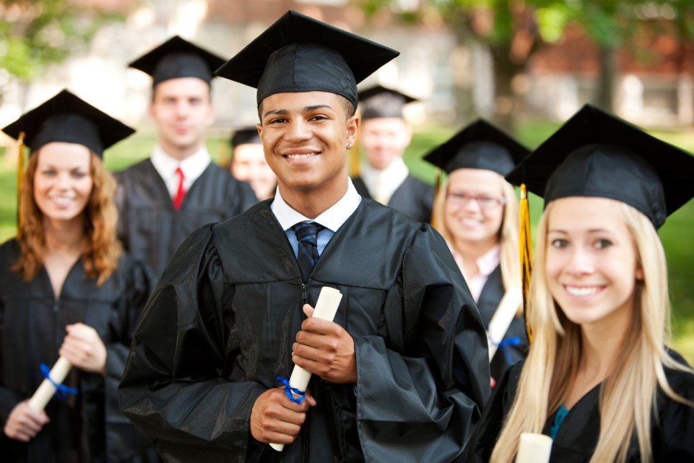 Extensive series of a multi-ethnic group of high school or college students after a graduation ceremony. Candid and posed images, some with diplomas.