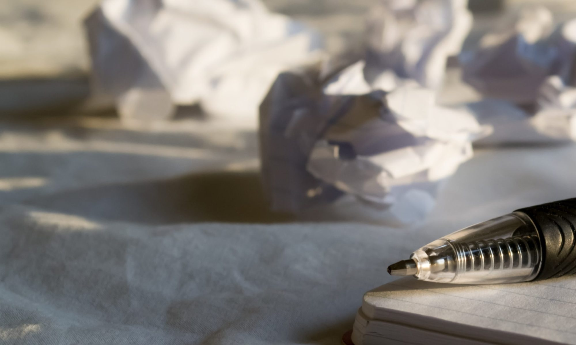crumpled paper trying to overcome writer's block