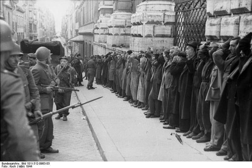 Italian civilians arrested in Rome by German troops after attack on German soldiers.