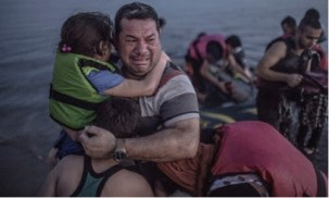 Laith Majid cries tears of joy and relief that he and his children have made it to Europe. (Daniet Etter/New York Times/Redux )