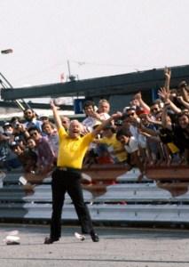 Lotus Team Principle Colin Chapman celebrates a win in 1978