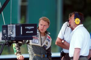 Mika Hakkinen (FIN) (left) studies the official timing screens with Lotus team owner Peter Collins (GBR, right) Mika scraped into the race by 0.07s. Belgian Grand Prix, Spa-Francorchamps, 25 August 1991.
