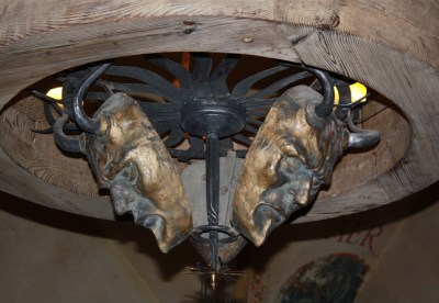 Chandelier featuring multiple horned heads of Moses