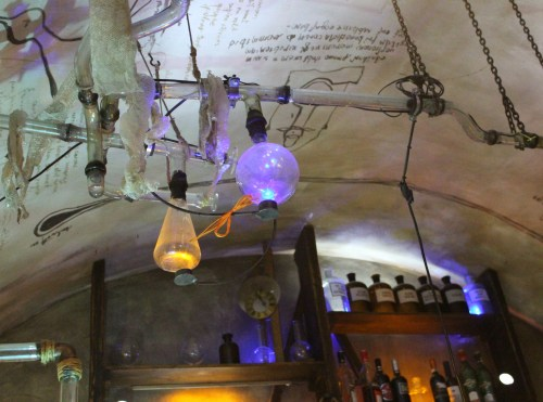 ceiling of Kellyxir alchemical pub with glassware and tubing
