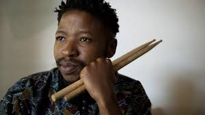 Tumi Mogorosi with sticks