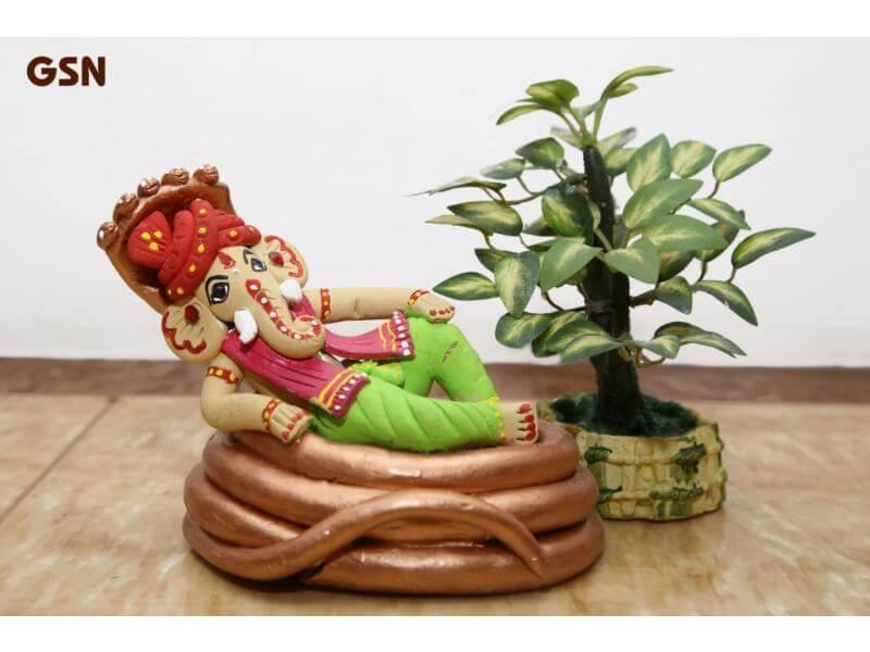 Terracotta Ganesh Sitting on Sheshnaag (Height: 5 Inch, Width: 5 Inch)