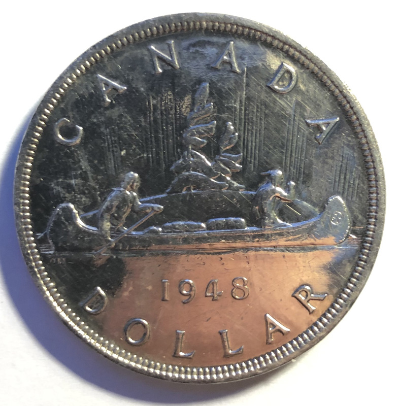 Reverse showing Voyageurs and 1948