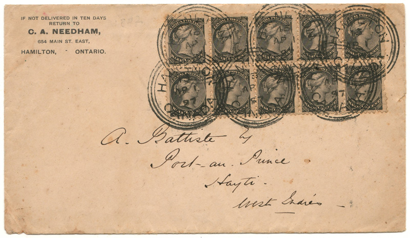 front of envelope with stamps and handwritten address