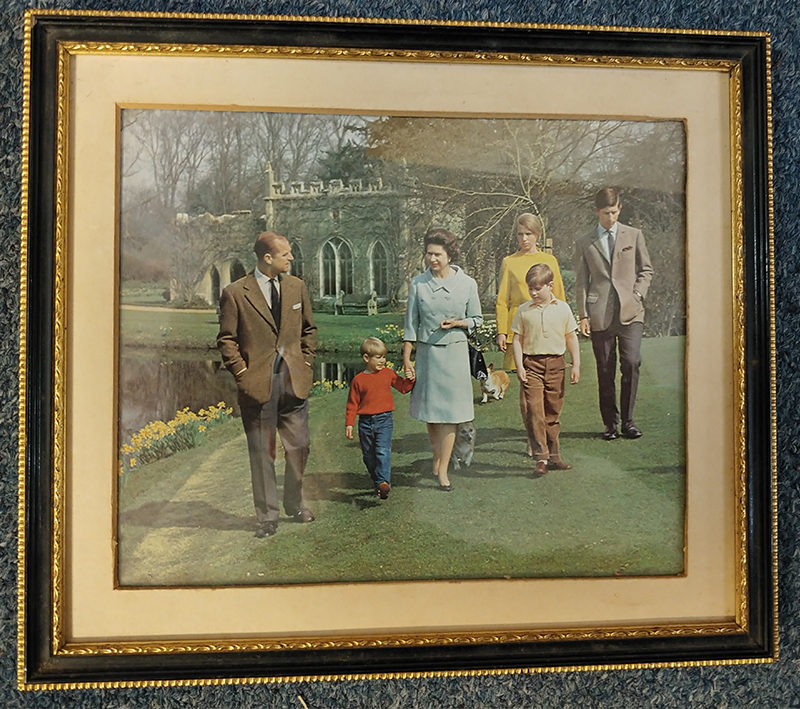 same Colour photograph of royal family, behind glass of frame