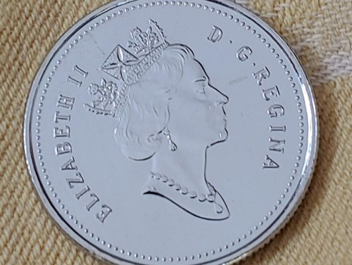 Canada Unc 1999 undenominated November 25 Cents Mule error