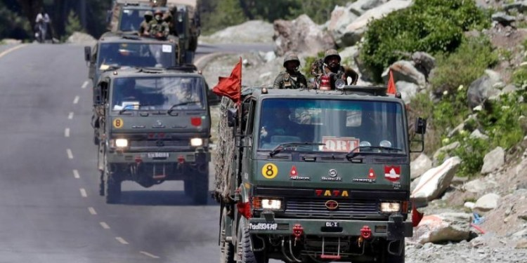 FILE PHOTO: An Indian Army convoy moves along a highway leading to Ladakh, at Gagangeer in Kashmir's Ganderbal district June 18, 2020. REUTERS/Danish Ismail/File Photo