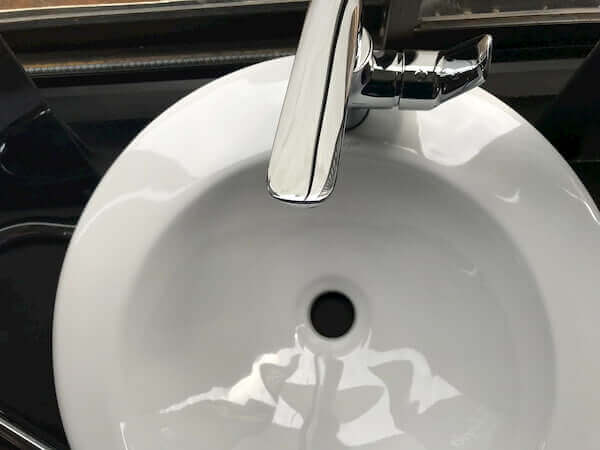 to clean your bathroom sink faucets